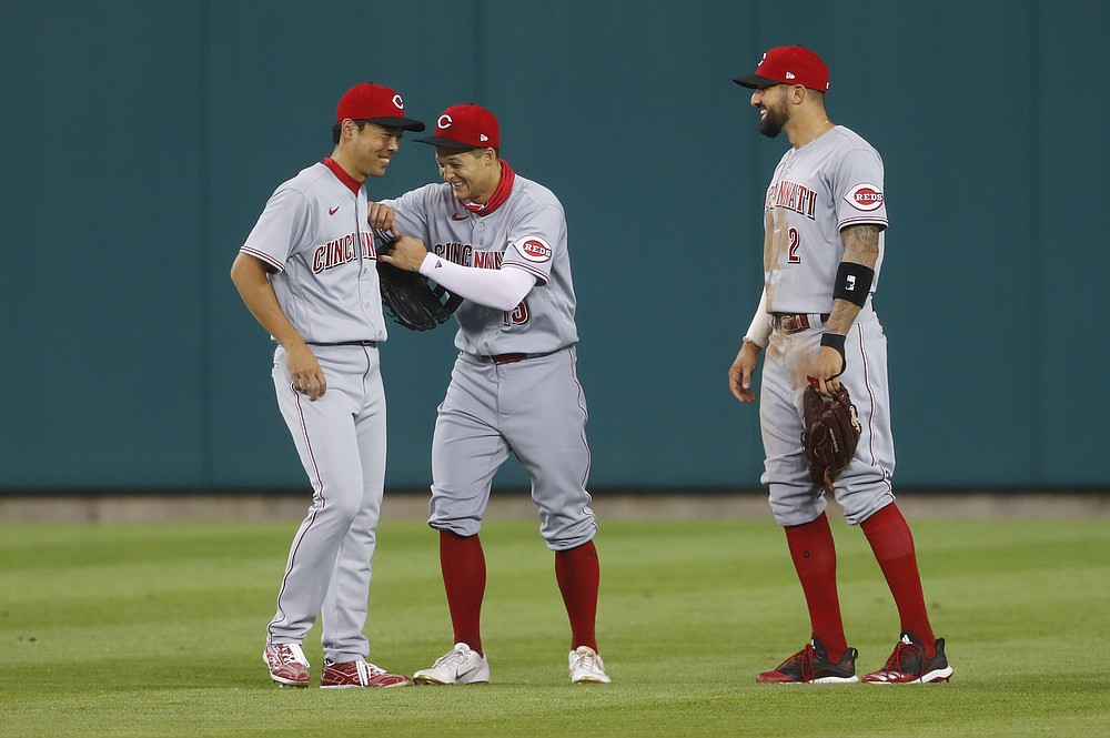 Cincinnati Reds outfielders Shogo Akiyama, from left, Nick Senzel (15) and Nicholas Castellanos (2) laugh together during a break in play in the seventh inning of a baseball game against the Detroit Tigers in Detroit, Friday, July 31, 2020. (AP Photo/Paul Sancya)
