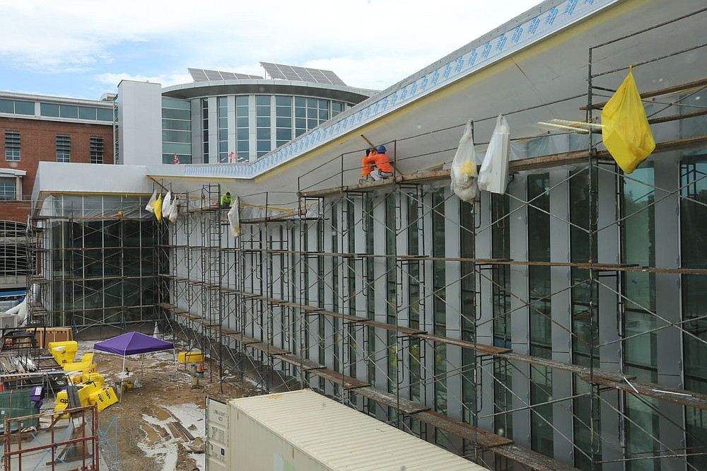 A view of the west facing side Thursday, July 30, 2020, of the the new expansion in the Fayetteville Public Library still under construction. The new addition of 82,500-square-feet will nearly double the size of the 88,000-square-foot main library. Check out nwaonline.com/200802Daily/ and nwadg.com/photos for a photo gallery. (NWA Democrat-Gazette/David Gottschalk)