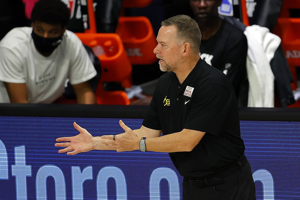 Denver Nuggets head coach Michael Malone reacts against the Miami Heat  during an NBA basketball game, Saturday, Aug. 1, 2020, in Lake Buena Vista, Fla. (Kevin C. Cox/Pool Photo via AP)