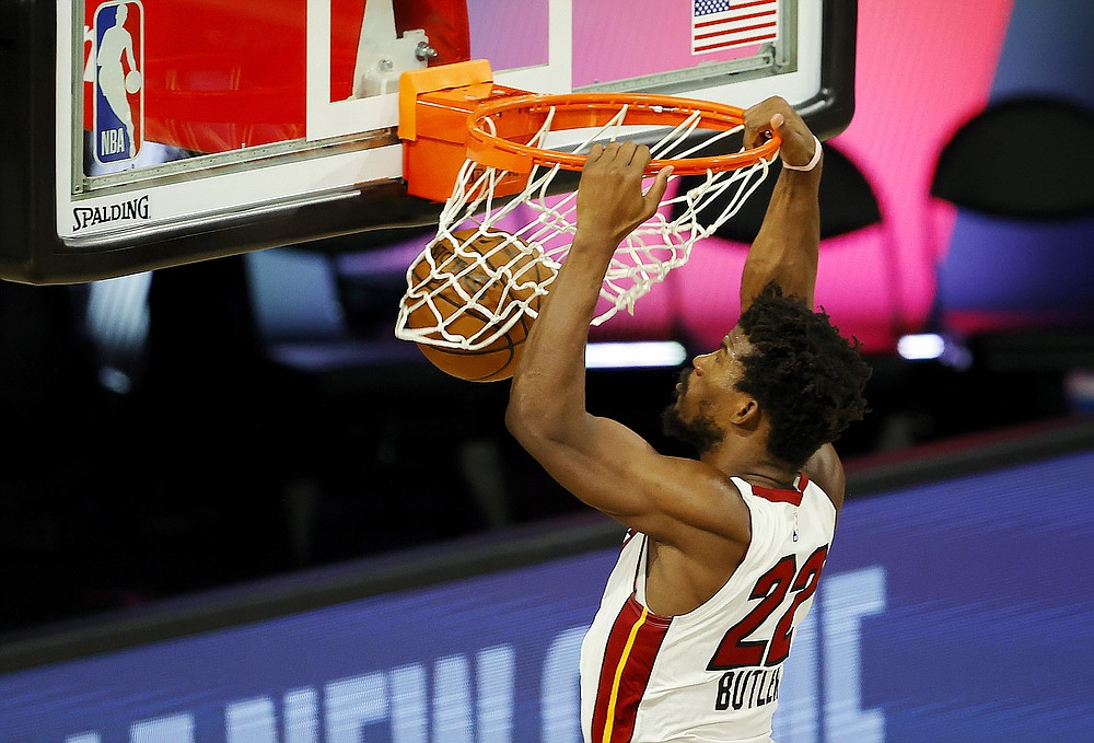 Miami Heat's  Jimmy Butler dunks against the Denver Nuggets during an NBA basketball game, Saturday, Aug. 1, 2020, in Lake Buena Vista, Fla. (Kevin C. Cox/Pool Photo via AP)