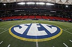 FILE - In this Dec. 5, 2014, file photo, the SEC logo is displayed on the field ahead of the Southeastern Conference championship football game between Alabama and Missouri in Atlanta. The Southeastern Conference will play only league games in 2020 to deal with potential COVID-19 disruptions, a decision that pushes major college football closer to a siloed regular season in which none of the power conferences cross paths(AP Photo/John Bazemore, File)