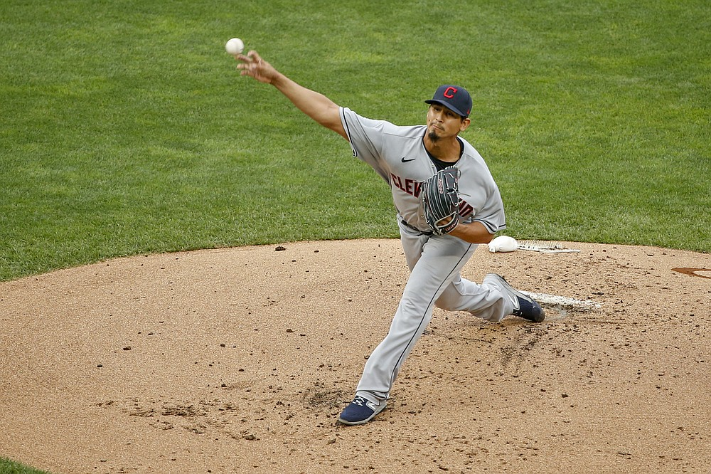 Cleveland Indians starting pitcher Carlos Carrasco throws to a Minnesota Twins batter during the first inning of a baseball game Saturday, Aug. 1, 2020, in Minneapolis. (AP Photo/Bruce Kluckhohn)