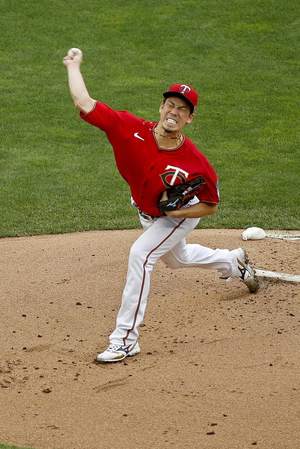 Minnesota Twins starting pitcher Kenta Maeda throws to a Cleveland Indians batter during the first inning of a baseball game Saturday, Aug. 1, 2020, in Minneapolis. (AP Photo/Bruce Kluckhohn)