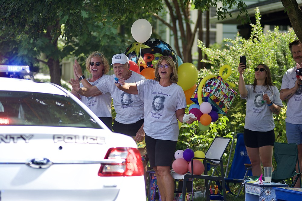 Dan Willkens with his family at the surprise birthday parade. MUST CREDIT: Photo courtesy of Diane Willkens