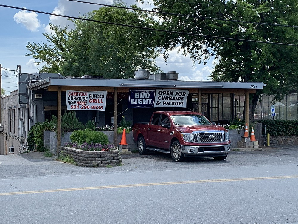 Buffalo Grill has reopened in Riverdale for curbside to-go service after an employee's positive covid-19 test caused them to temporarily shut their doors.  (Arkansas Democrat-Gazette/Eric E. Harrison)