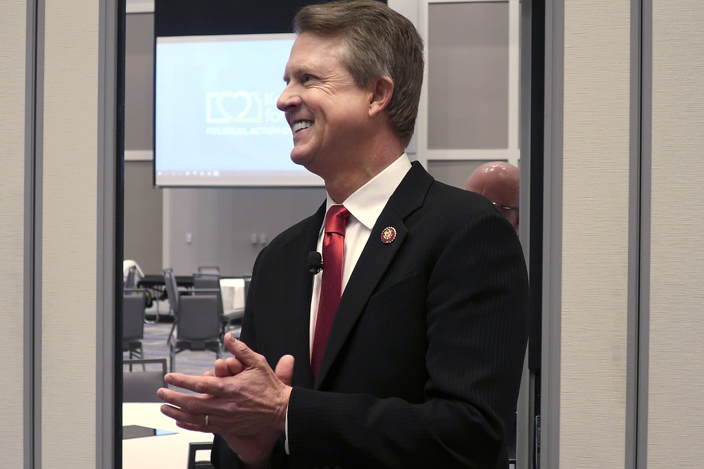 FILE - In this Feb. 1, 2020 file photo, U.S. Rep. Roger Marshall, R-Kan., a candidate for the U.S. Senate, awaits the start of a debate in Olathe, Kansas,Establishment Republicans worried heading into Kansas' primary Tuesday, Aug. 4, 2020 for an open Senate that weeks of effort to thwart polarizing conservative Kris Kobach would falter because they couldn't persuade President Donald Trump to endorse their favored candidate. (AP Photo/John Hanna, File)