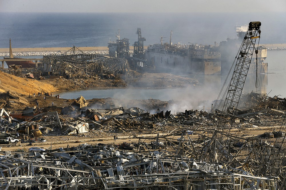 This photo shows a general view of the scene of an explosion that hit the seaport of Beirut, Lebanon, Wednesday, Aug. 5, 2020. The massive explosion rocked Beirut on Tuesday, flattening much of the city's port, damaging buildings across the capital and sending a giant mushroom cloud into the sky. (AP Photo/Bilal Hussein)