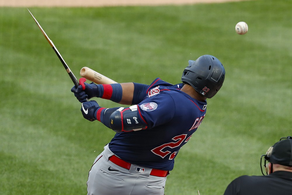 Minnesota Twins' Nelson Cruz gets a broken bat single off Pittsburgh Pirates starting pitcher Trevor Williams in the first inning of a baseball game, Wednesday, Aug. 5, 2020, in Pittsburgh. (AP Photo/Keith Srakocic)