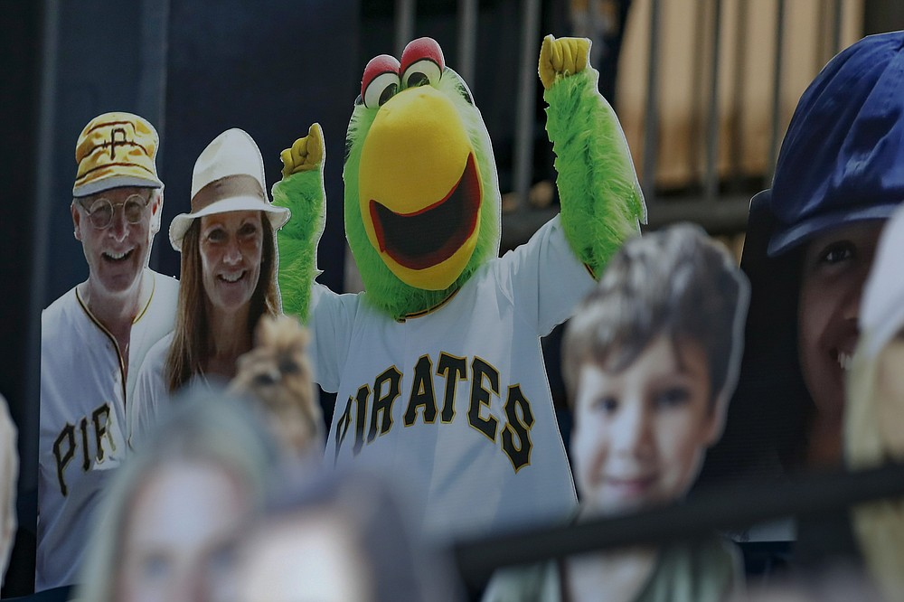 An image of the Pittsburgh Pirates Parrot mascot is mixed in with other cutout spectators in the stands behind home plate at PNC Park before a baseball game between the Pittsburgh Pirates and the Minnesota Twins, Wednesday, Aug. 5, 2020, in Pittsburgh. (AP Photo/Keith Srakocic)