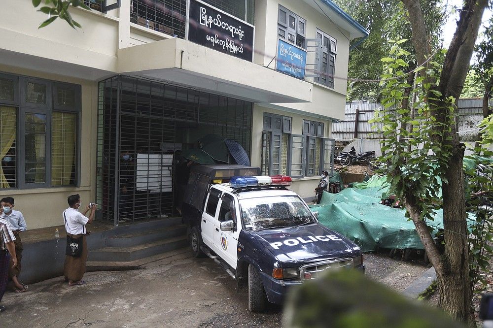 Canadian pastor David Lah, unseen, leaves a township court in a police vehicle after a hearing Thursday, Aug. 6, 2020, in Yangon, Myanmar. The court sentenced Lah to three months imprisonment after finding him guilty of violating a law intended to combat the spread of the coronavirus. (AP Photo/Thein Zaw)