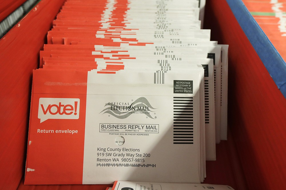 Vote-by-mail ballots are shown in a sorting tray, Wednesday, Aug. 5, 2020, at the King County Elections headquarters in Renton, Wash., south of Seattle. Never in U.S. history will so many people exercise the right on which their democracy hinges by marking a ballot at home. (AP Photo/Ted S. Warren)