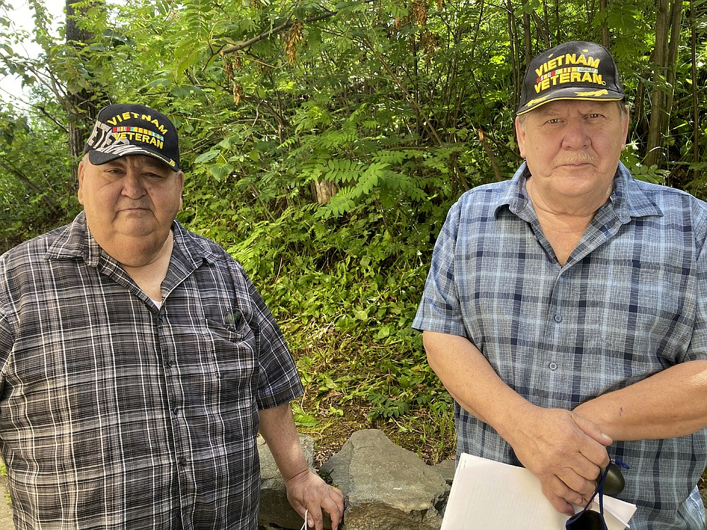 Chris Kiana, left, and Harold Rudolph pose for a photo July 20, 2020, in Anchorage, Alaska. The two Alaska Native Vietnam veterans are critical of a new government program that will allow Native veterans to apply for land that they might have missed out on in earlier programs because of their service. (AP Photo/Mark Thiessen)