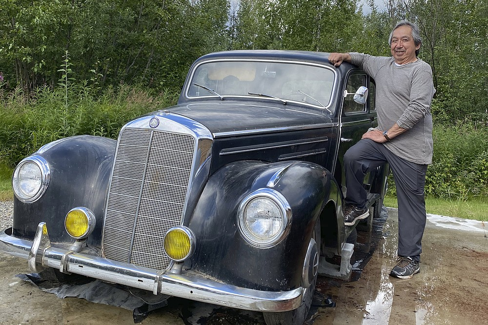This undated photo shows Wally Carlo posing with a 1951 Mercedes that his brother, Stewy, bought while he was serving in the Army during the Vietnam War. Stewy Carlo died in a car accident in 1975, but his brother will apply for an allotment of 160 acres of government-owned land in Alaska under a new program that will allow Alaska Native Vietnam veterans or their heirs to apply for land that they might have missed out on in earlier programs because of their service. (Photo by Seeyaa Charpentier via AP)