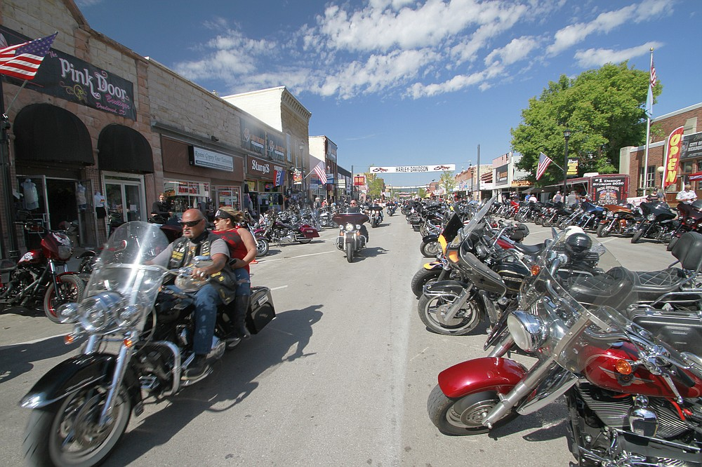 Thousands of bikers rode through the streets for the opening day of the 80th annual Sturgis Motorcycle rally Friday, Aug. 7, 2020, in Sturgis, S.D. (AP Photo/Stephen Groves)