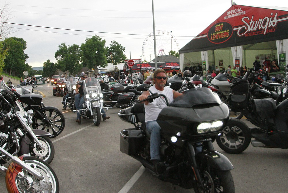 Bikers ride through downtown Sturgis, S.D., on Friday, Aug. 7, 2020. Organizers of the Sturgis Motorcycle Rally expect 250,000 people to visit the town of Sturgis during the 10 day rally.  (AP Photo/Stephen Groves)