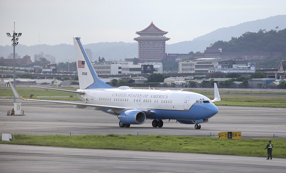 A plane carrying U.S. Health and Human Services Secretary Alex Azar lands at Taipei Songshan Airport in Taipei, Taiwan, Sunday, Aug. 9, 2020. Azar arrived in Taiwan on Sunday in the highest-level visit by an American Cabinet official since the break in formal diplomatic relations between Washington and Taipei in 1979. (AP Photo/Chiang Ying-ying)