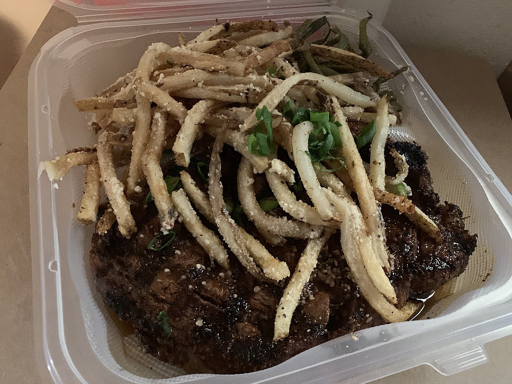 The ribeye steak from Maddie's Place came with parmesan fries and haricots verts. (Arkansas Democrat-Gazette/Eric E. Harrison)