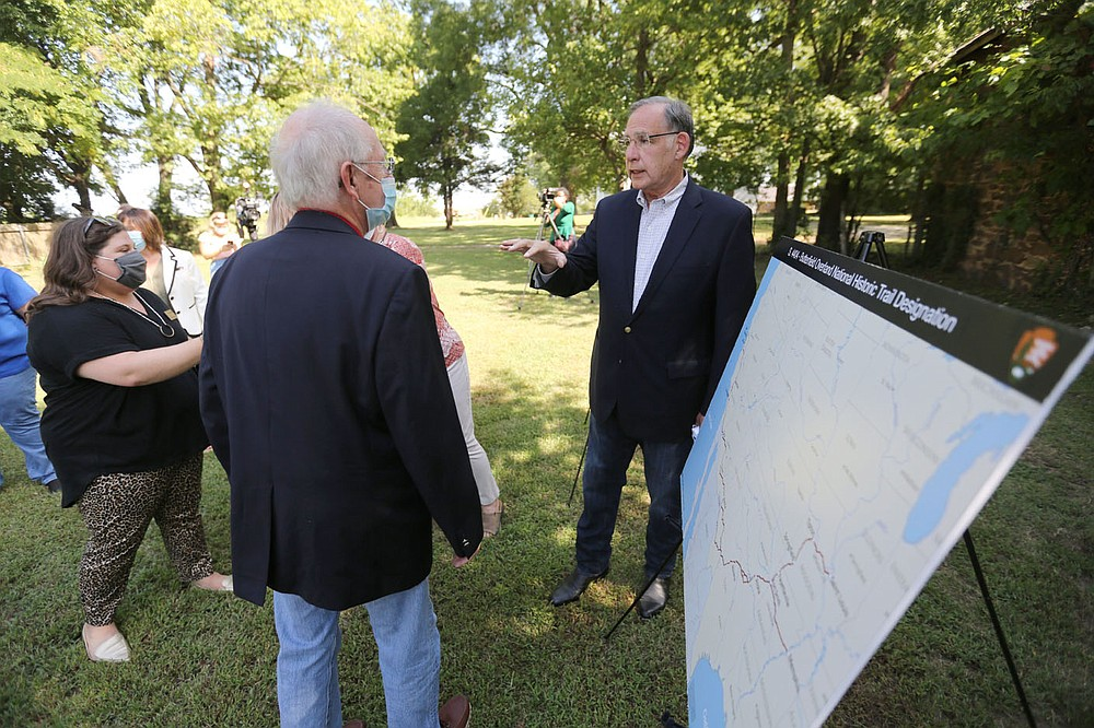 U.S. Senator John Boozman (right) speaks with those in attendance Monday, August 10, 2020, after he announced he has filed a bill to make the Butterfield Overland Trail a national historic trail in Springdale. The Fitzgerald Station site was a stagecoach stop on the Butterfield Overland Mail route in the 1850s. About 337 miles of the 3,000 miles of the two branches of the historic trail went through Arkansas. Check out nwaonline.com/200811Daily/ and nwadg.com/photos for a photo gallery. (NWA Democrat-Gazette/David Gottschalk)