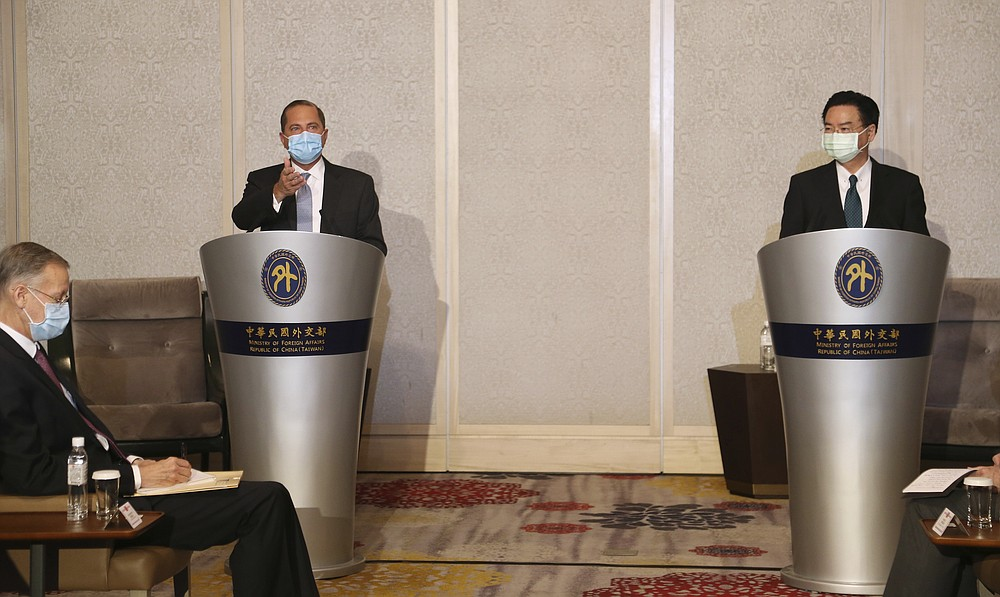 U.S. Health and Human Services Secretary Alex Azar, left, speaks during a meeting with Taiwanese Foreign Minister Joseph Wu in Taipei, Taiwan Tuesday, Aug. 11, 2020. Azar met with Wu on Tuesday during the highest-level visit by an American Cabinet official since the break in formal diplomatic ties between Washington and Taipei in 1979. (AP Photo/Chiang Ying-ying)