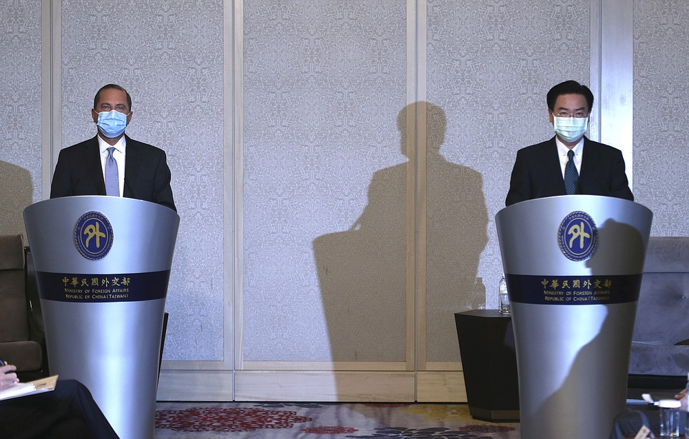 U.S. Health and Human Services Secretary Alex Azar, left, speaks, along with Taiwanese Foreign Minister Joseph Wu at the start of their meeting in Taipei, Taiwan Tuesday, Aug. 11, 2020. Azar met with Wu on Tuesday during the highest-level visit by an American Cabinet official since the break in formal diplomatic ties between Washington and Taipei in 1979. (AP Photo/Chiang Ying-ying)