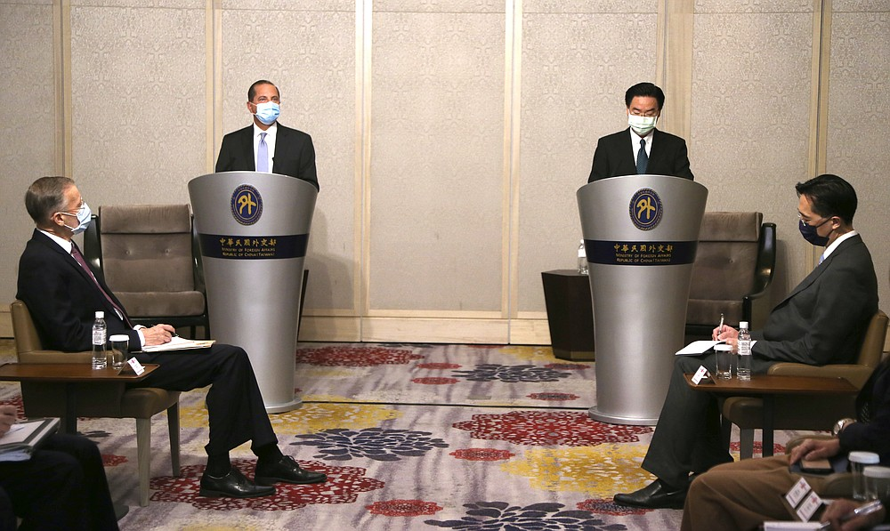 U.S. Health and Human Services Secretary Alex Azar, second from left, speaks at the start of a meeting with Taiwanese Foreign Minister Joseph Wu, standing at right, in Taipei, Taiwan Tuesday, Aug. 11, 2020. Azar met with Wu on Tuesday during the highest-level visit by an American Cabinet official since the break in formal diplomatic ties between Washington and Taipei in 1979. (AP Photo/Chiang Ying-ying)