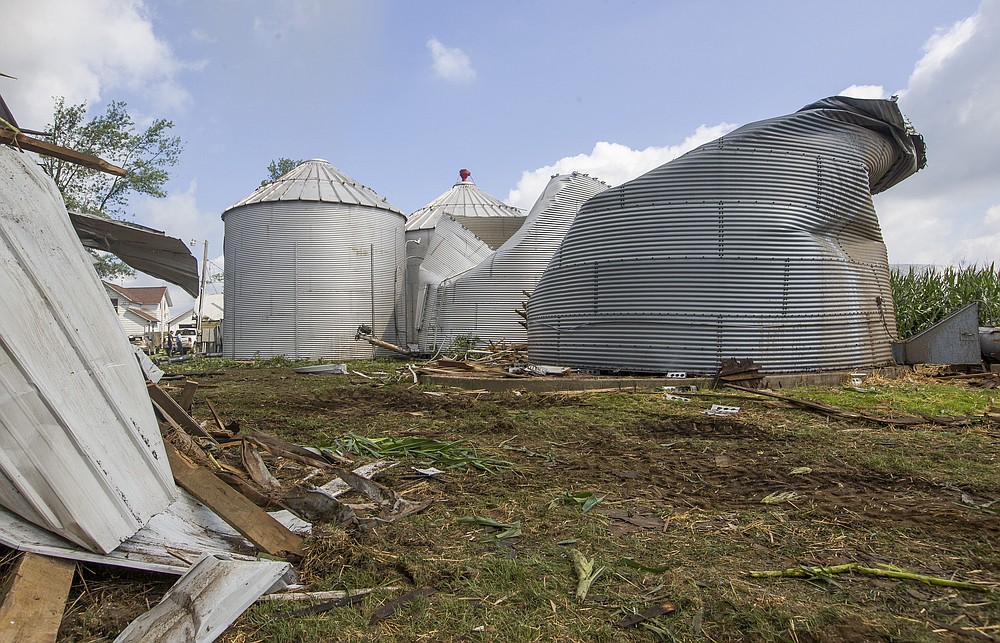 Residents begin cleaning up storm damage from dangerous straight-line winds and possible tornadoes caused by a rare derecho on Tuesday, Aug. 11, 2020, in Wakarusa, Ind. (Robert Franklin/South Bend Tribune via AP)