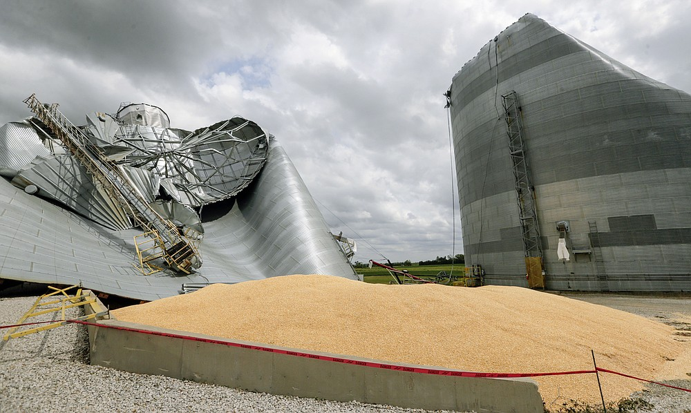 Grain bins are seen severely damaged on the Archer Daniels Midland facility in Keystone, Iowa, on Wednesday, Aug. 12, 2020. A storm slammed the Midwest with straight line winds of up to 100 miles per hour on Monday, gaining strength as it plowed through Iowa farm fields, flattening corn and bursting grain bins still filled with tens of millions of bushels of last year's harvest. (Jim Slosiarek/The Gazette via AP)
