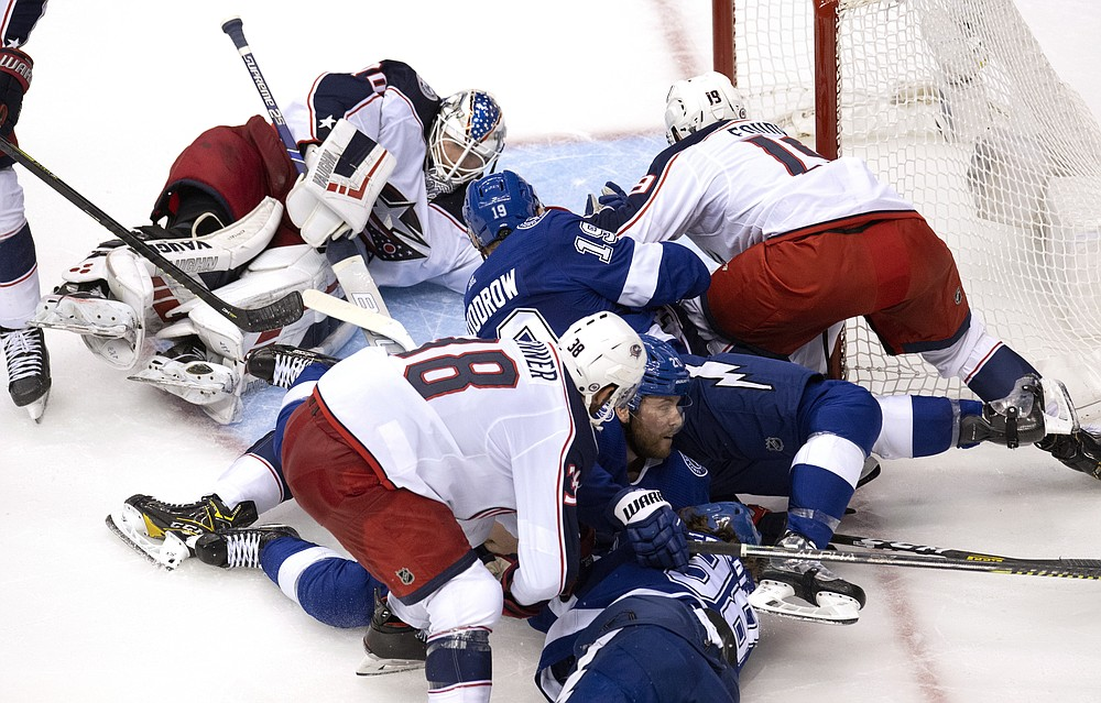 Columbus Blue Jackets goaltender Joonas Korpisalo (70) defends the goal as the Tampa Bay Lightning and the Blue Jackets battle in the crease during second-period of NHL Eastern Conference Stanley Cup first round playoff hockey game action in Toronto, Thursday, Aug. 13, 2020. (Frank Gunn/The Canadian Press via AP)