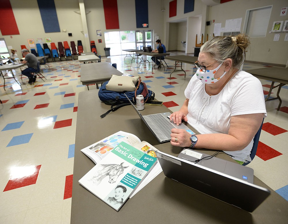 Michele McGuire, an art teacher at West Fork High School, works Friday, July 31, 2020, to build an online curriculum during a workshop for teachers at West Fork Elementary School. Visit nwaonline.com/200801Daily/ for today's photo gallery. (NWA Democrat-Gazette/Andy Shupe)