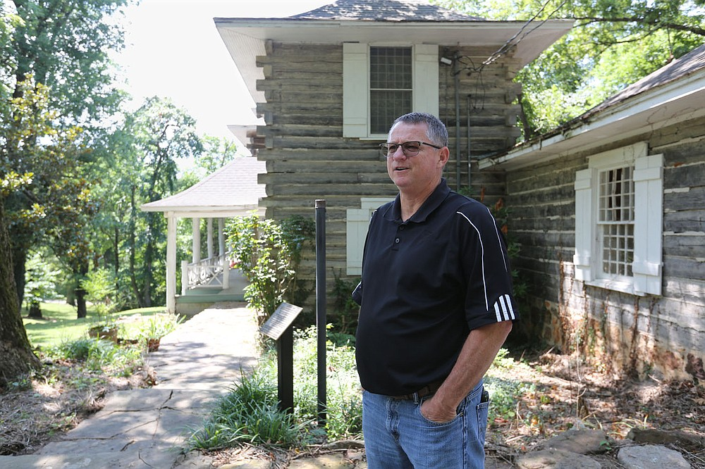 Chad Wolf, director of the city of Springdale Parks and Recreation, describes the exterior of Rabbit Foot Lodge Wednesday, August 5, 2020, located on the north end of J.B. Hunt Park in Springdale. The lodge was built in 1908-09 and placed on the National Register of Historic Places by the United States Department of the Interior in 1986. Check out nwaonline.com/200809Daily/ and nwadg.com/photos for a photo gallery. (NWA Democrat-Gazette/David Gottschalk)