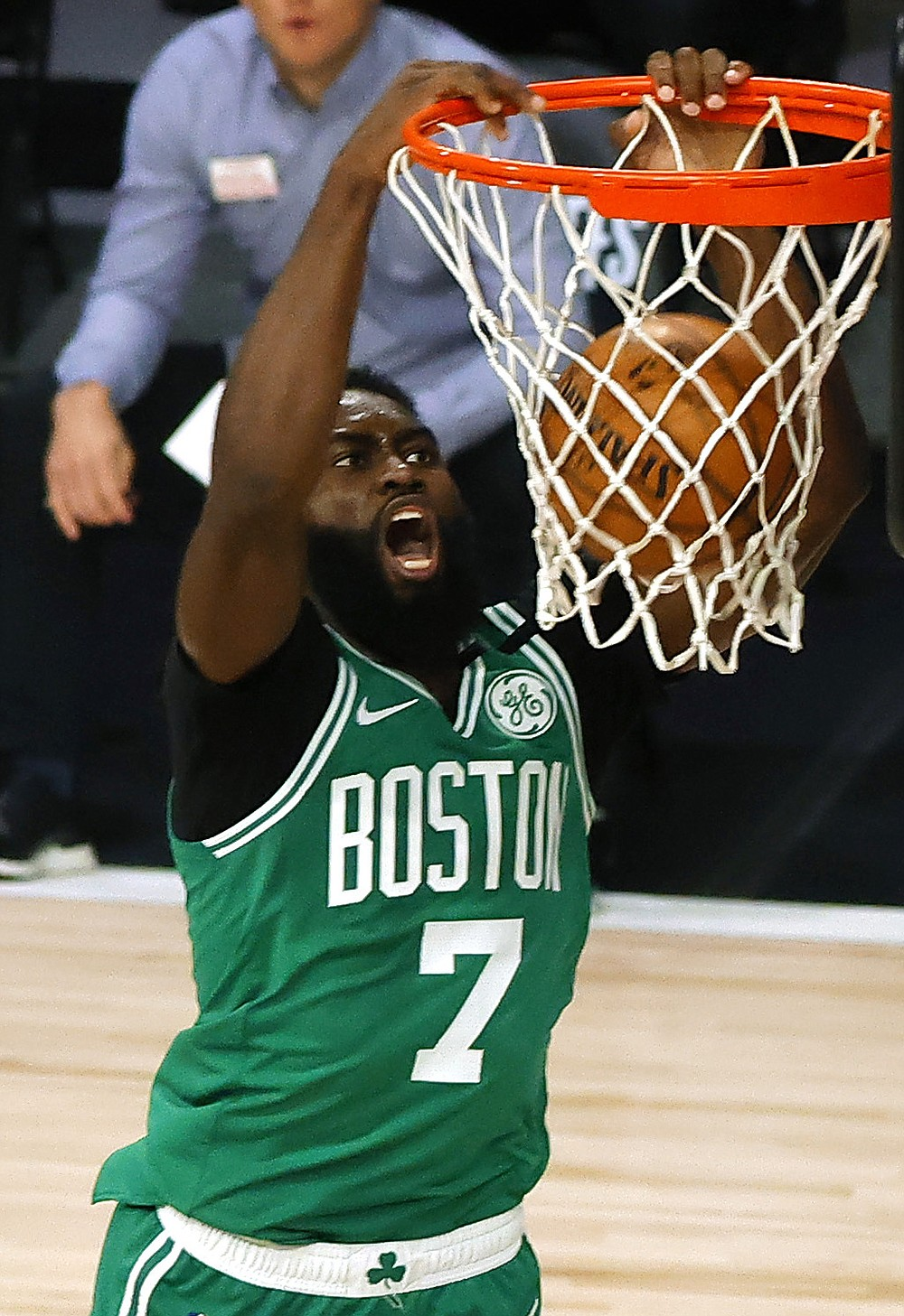 Boston Celtics' Jaylen Brown dunks against the Philadelphia 76ers during the first quarter of Game 2 of an NBA basketball first-round playoff series, Wednesday, Aug. 19, 2020, in Lake Buena Vista, Fla. (Kevin C. Cox/Pool Photo via AP)