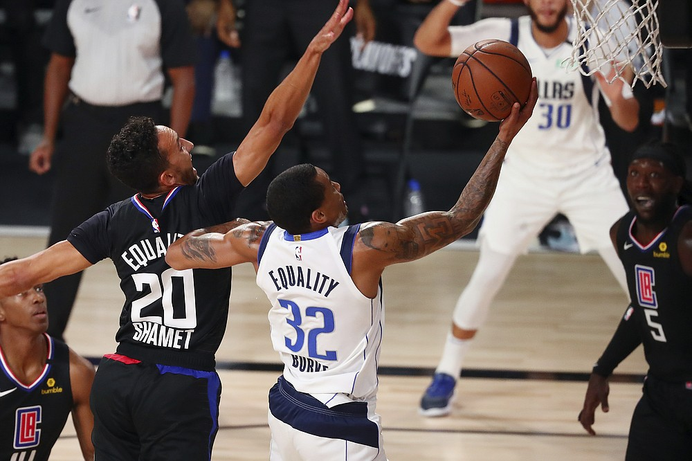 Dallas Mavericks guard Trey Burke (32) scores against Los Angeles Clippers guard Landry Shamet (20) during the second half of Game 2 of an NBA basketball first-round playoff series, Wednesday, Aug. 19, 2020, in Lake Buena Vista, Fla. (Kim Klement/Pool Photo via AP)