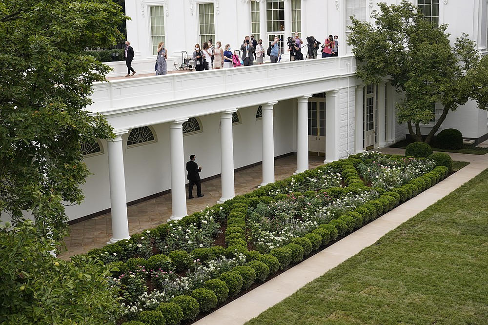 Journalists get an overhead view of the restored Rose Garden at the White House in Washington, Saturday, Aug. 22, 2020. First Lady Melania Trump will deliver her Republican National Convention speech Tuesday night from the garden, famous for its close proximity to the Oval Office. The three weeks of work on the garden, which was done in the spirit of its original 1962 design, were showcased to reporters on Saturday. (AP Photo/Susan Walsh)