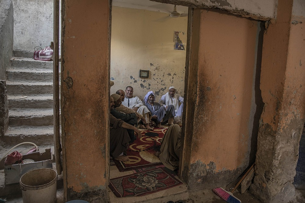 "55-year-old Egyptian farmer Makhluf Abu Kassem, left, sits with farmers in his home, in Second Village, Qouta town, Fayoum, Egypt, Saturday, Aug. 8, 2020. Abu Kassem fears that a dam Ethiopia is building on the Blue Nile, the Nile's main tributary, could add to the severe water shortages already hitting his village if no deal is struck to ensure a continued flow of water. ""The dam means our death,"" he said. (AP Photo/Nariman El-Mofty)"