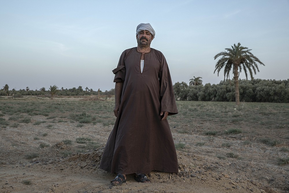 "55-year-old Egyptian farmer Makhluf Abu Kassem, stands on a land that was once fertile, in Second Village, Qouta town, Fayoum, Egypt, Saturday, Aug. 8, 2020. Abu Kassem fears that a dam Ethiopia is building on the Blue Nile, the Nile's main tributary, could add to the severe water shortages already hitting his village if no deal is struck to ensure a continued flow of water. ""The dam means our death,"" he said. (AP Photo/Nariman El-Mofty)"