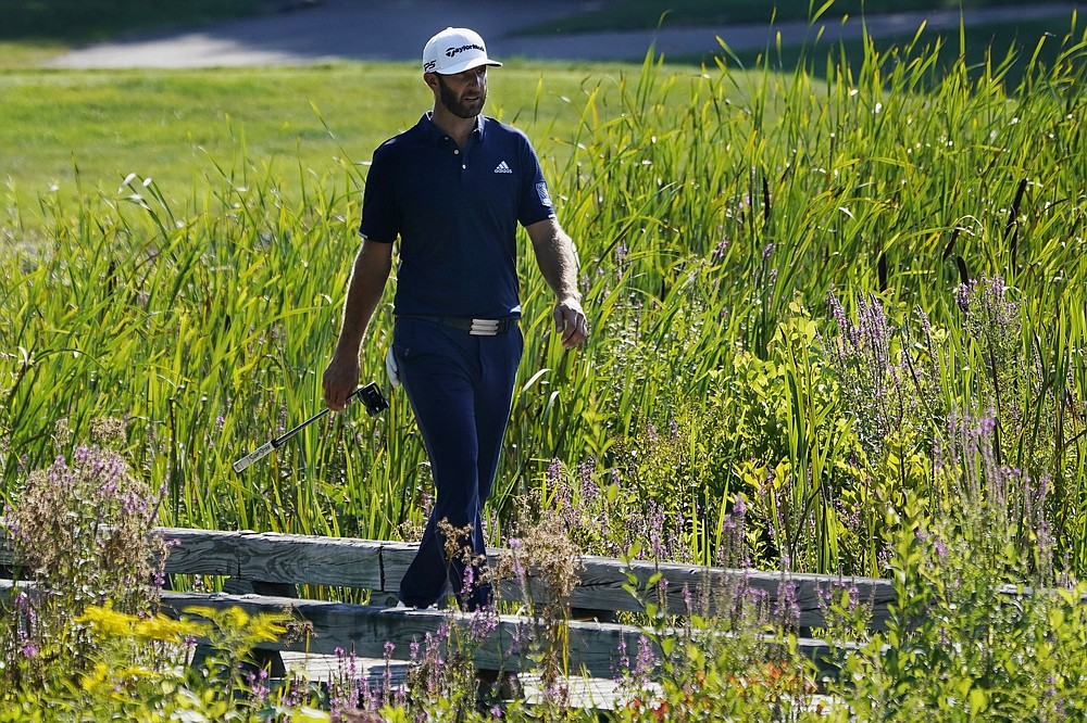 Dustin Johnson walks to the eighth green during the final round of the Northern Trust golf tournament at TPC Boston, Sunday, Aug. 23, 2020, in Norton, Mass. (AP Photo/Charles Krupa)