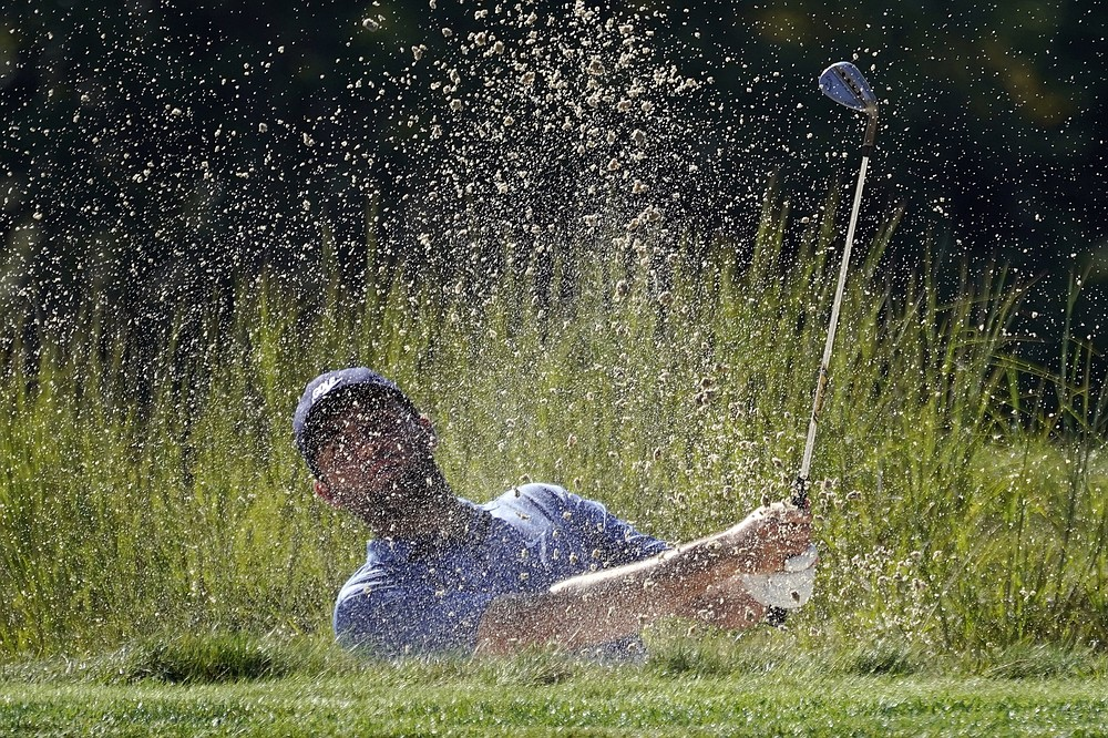 Scottie Scheffler hits out of a bunker on the eighth hole during the final round of the Northern Trust golf tournament at TPC Boston, Sunday, Aug. 23, 2020, in Norton, Mass. (AP Photo/Charles Krupa)