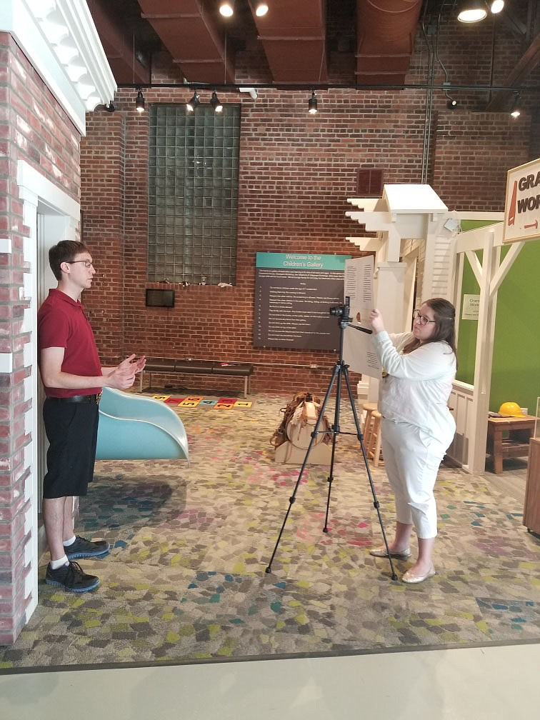 Education assistants Ashley Sayers and Glen Christophersen have spent some of the summer learning about video editing software and filming segments of the AT HOME Kid's Craft Corner.  (Courtesy Photos)