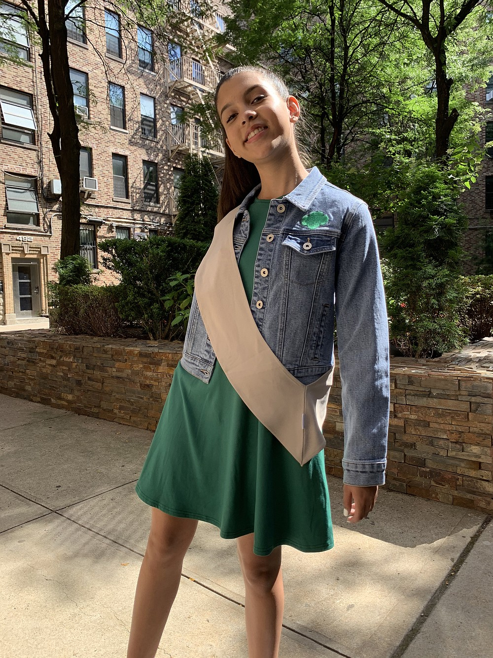 In an undated image provided by the Girl Scouts of the USA, the Girl Scouts have new uniforms. A vest designed for the modern Girl Scout must have pockets, and those pockets must be large enough to fit the largest model of the iPhone. (Girl Scouts of the USA via The New York Times) -- NO SALES; FOR EDITORIAL USE ONLY WITH NYT STORY GIRL SCOUTS UNIFORM BY JESSICA TESTA FOR AUG. 25, 2020. ALL OTHER USE PROHIBITED. --