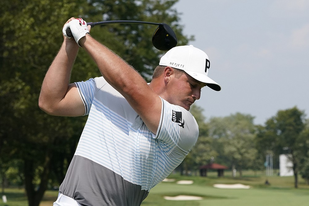 Bryson DeChambeau swings on his tee shot during a practice round Wednesday, Aug. 26, 2020, for the BMW Championship golf tournament at the Olympia Fields Country Club in Olympia Fields, Ill. (AP Photo/Charles Rex Arbogast)