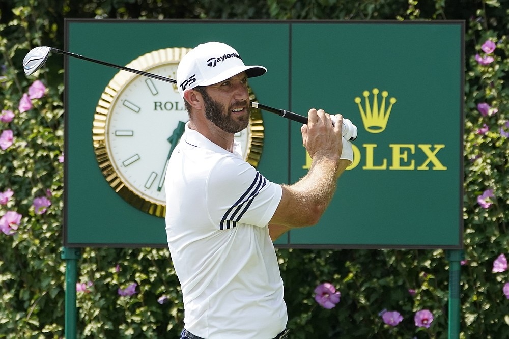 Dustin Johnson watches his tee shot during a practice round Wednesday, Aug. 26, 2020, for the BMW Championship golf tournament at the Olympia Fields Country Club in Olympia Fields, Ill. (AP Photo/Charles Rex Arbogast)