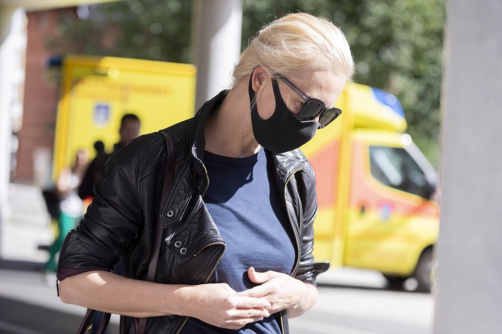 The wife of the Russian oppositional Alexei Navalny, Julia,  arrives at the Berlin Charite Tuesday, Aug.25, 2020.  The Russian oppositional Navalny is treated in the clinic. Doctors at the Berlin Charité Hospital assume that the Kremlin critic has been poisoned. (Christoph Soeder/dpa via AP)
