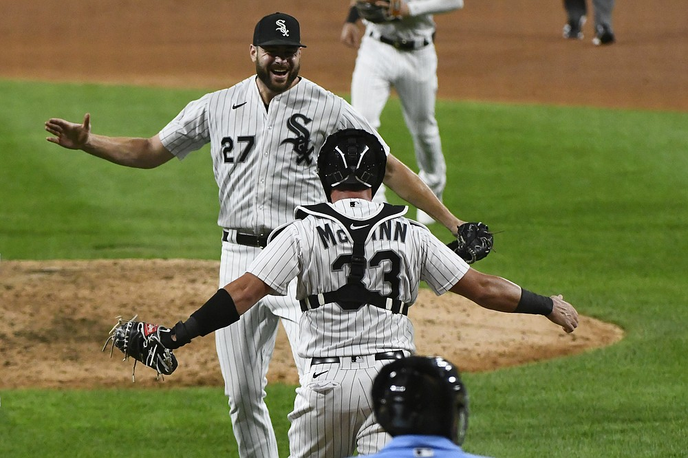 Chicago White Sox starting pitcher Lucas Giolito (27) celebrates with catcher James McCann (33) after closing out a no-hitter in the team's baseball game against the Pittsburgh Pirates, Tuesday, Aug. 25, 2020, in Chicago. The White Sox won 4-0. (AP Photo/Matt Marton)