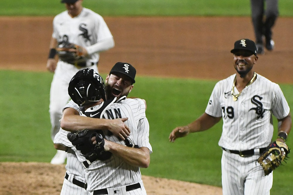 Chicago White Sox starting pitcher Lucas Giolito celebrates with catcher James McCann (33) after closing out a no-hitter in the team's baseball game against the Pittsburgh Pirates, Tuesday, Aug. 25, 2020, in Chicago. The White Sox won 4-0. (AP Photo/Matt Marton)