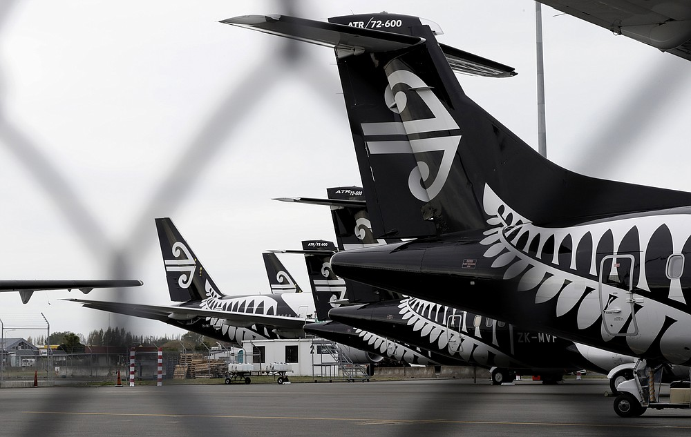 FILE - In this April 6, 2020 file photo, Air New Zealand planes sit idle on the tarmac at Christchurch Airport, New Zealand. The United Nations Secretary-General Antonio Guterres on Tuesday, Aug. 25, 2020, said the global tourism industry has been devastated by the coronavirus pandemic, with $320 billion lost in exports in the first five months of the year and more than 120 million jobs at risk. (AP Photo/Mark Baker, File)