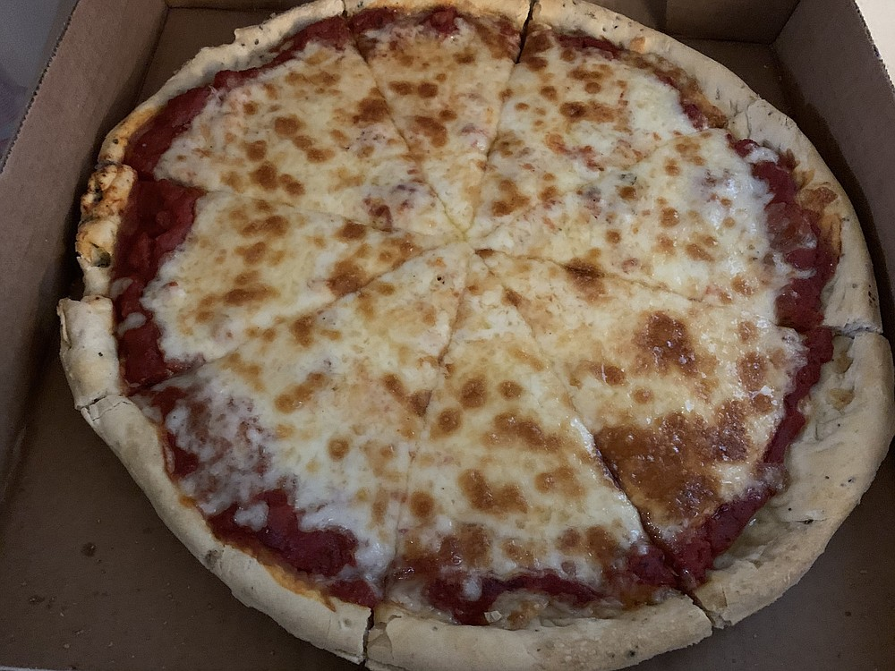 The medium (13-inch) Big Cheese pizza on traditional crust from the newly opened Gusano's Chicago-Style Pizza will please cheese lovers.  (Arkansas Democrat-Gazette/Eric E. Harrison)