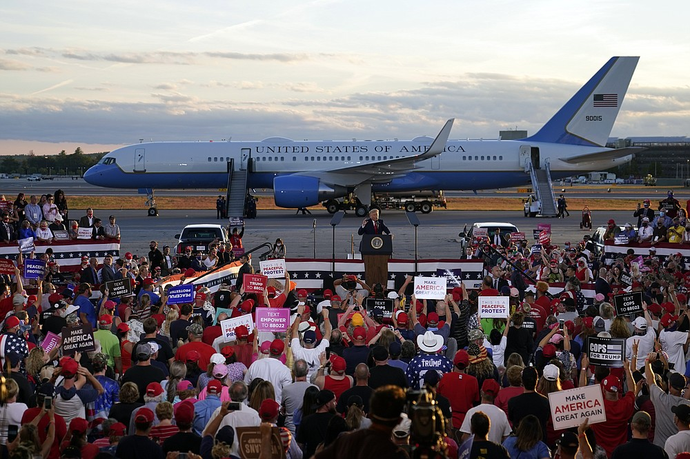 President Donald Trump speaks during a campaign rally at Manchester-Boston Regional Airport, Friday, Aug. 28, 2020, in Londonderry, N.H. (AP Photo/Charles Krupa)