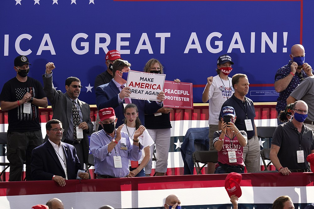 People wait for a campaign rally for President Donald Trump to begin at Manchester-Boston Regional Airport, Friday Aug. 28, 2020 in Londonderry, N.H. (AP Photo/Charles Krupa)