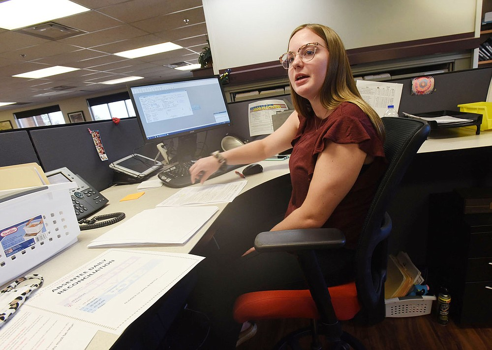 Kelsi Crawford processes abentee ballot requests on Tuesday Aug. 18 2020 at the Benton County clerk's office in downtown Bentonville. (NWA Democrat-Gazette/Flip Putthoff)