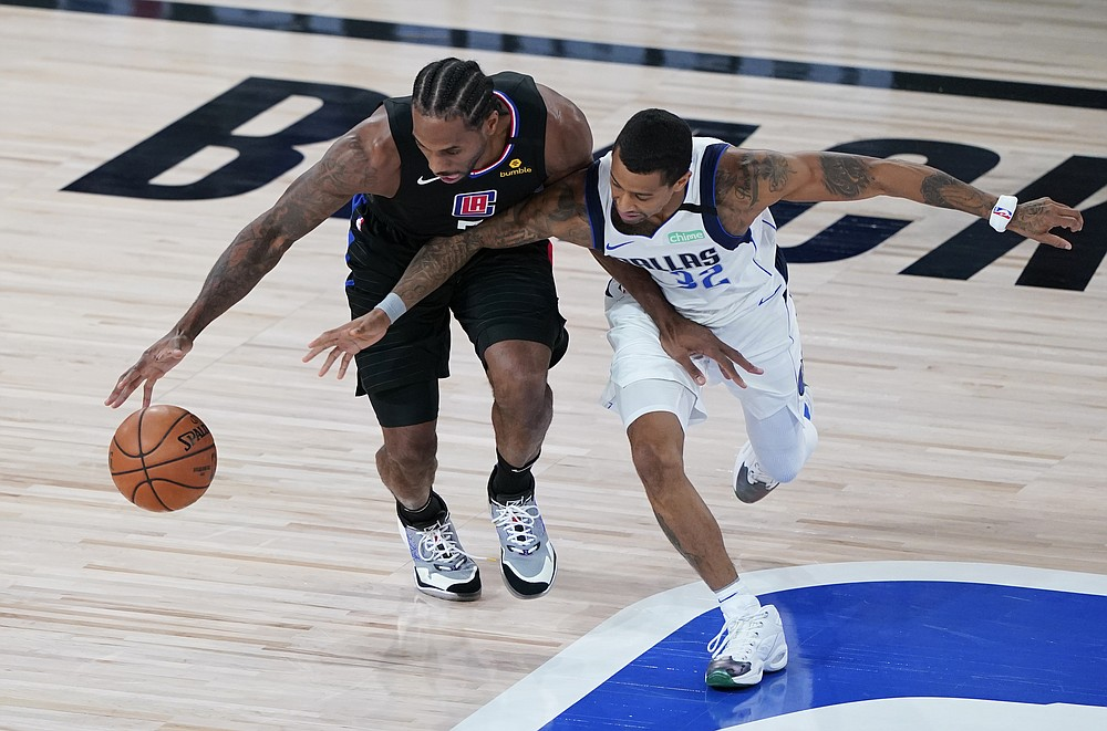Los Angeles Clippers' Kawhi Leonard (2) goes around Dallas Mavericks' Trey Burke during the first half of an NBA first round playoff game Sunday, Aug. 30, 2020, in Lake Buena Vista, Fla. (AP Photo/Ashley Landis)
